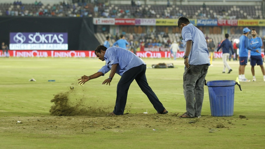 The Hyderabad groundstaff sprinkle sawdust on wet patches