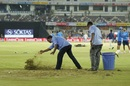 The groundstaff sprinkle sawdust on wet patches, India v Australia, 3rd T20I, Hyderabad, October 13, 2017