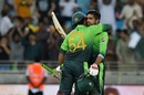 Babar Azam is pulled into an embrace by his captain after raising his sixth ODI century, Pakistan v Sri Lanka, 1st ODI, Dubai, October 13, 2017