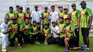 Bangladesh A celebrate their win with the trophy