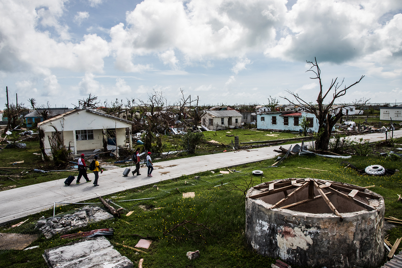People inspect the damage in Barbuda after Hurricane Irma