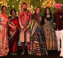 Mohammad Kaif with Yuvraj Singh and his wife Hazel Keech at their wedding reception, Delhi, December 7, 2016