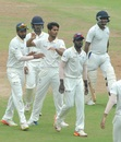 K Vignesh is mobbed by his team-mates, Tamil Nadu v Tripura, Ranji Trophy 2017-18, second round, 2nd day, Chennai, October 15, 2017