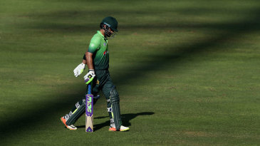 Ahmed Shehzad walks back to the dressing room after being dismissed