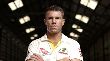 David Warner poses in Australia's new Test kit at a promotional event