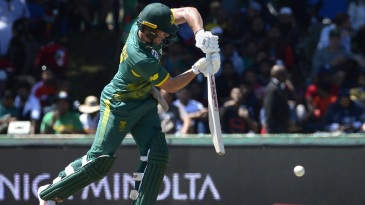 AB de Villiers punches with a high elbow