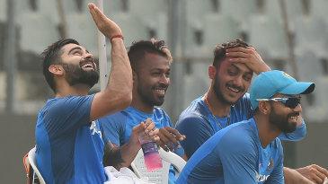 Virat Kohli enjoys a light moment with team-mates