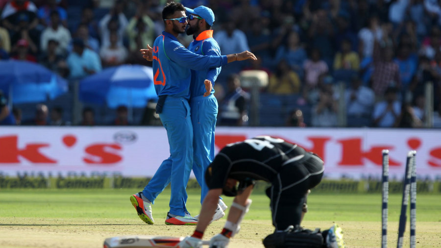 Axar Patel celebrates after dismissing Tom Latham