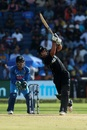 Colin de Grandhomme launches a six down the ground, India v New Zealand, 2nd ODI, Pune, 25 October, 2017
