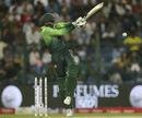 Shoaib Malik swivels back and pulls all along the ground