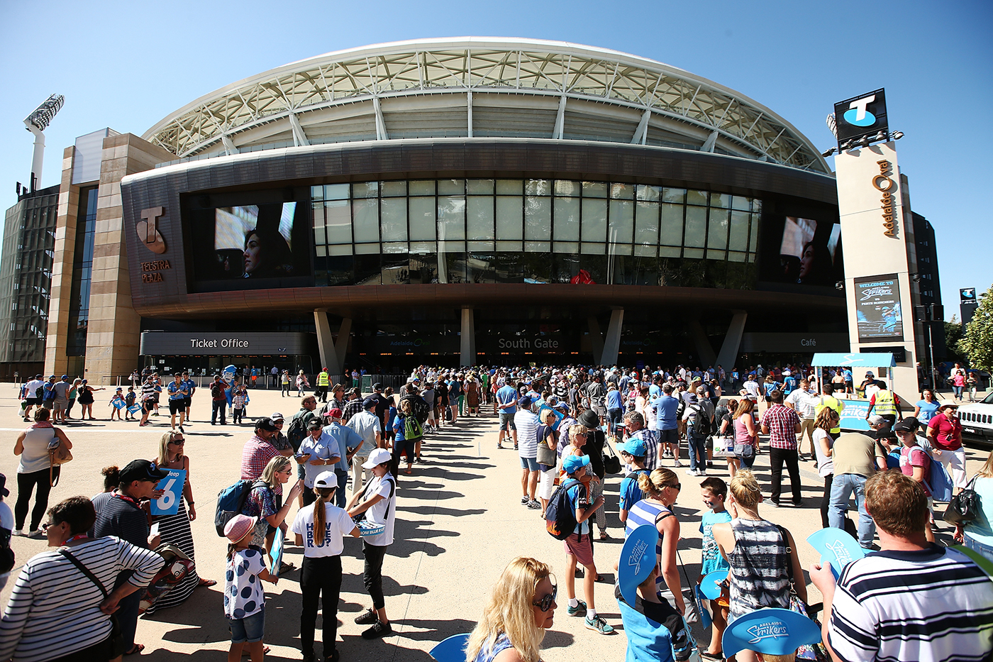 Spectators queue outside the Adelaide Oval to watch a Big Bash game