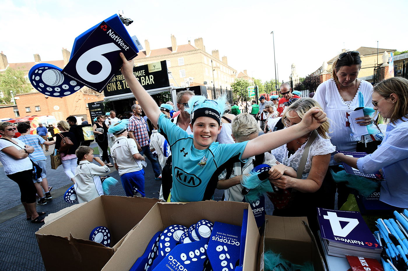 Surrey fans pick up free merchandise outside the Oval during a T20 Blast game