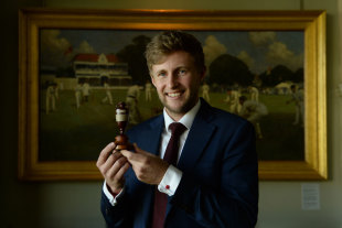 Joe Root poses with a replica of the Ashes urn at Lord's