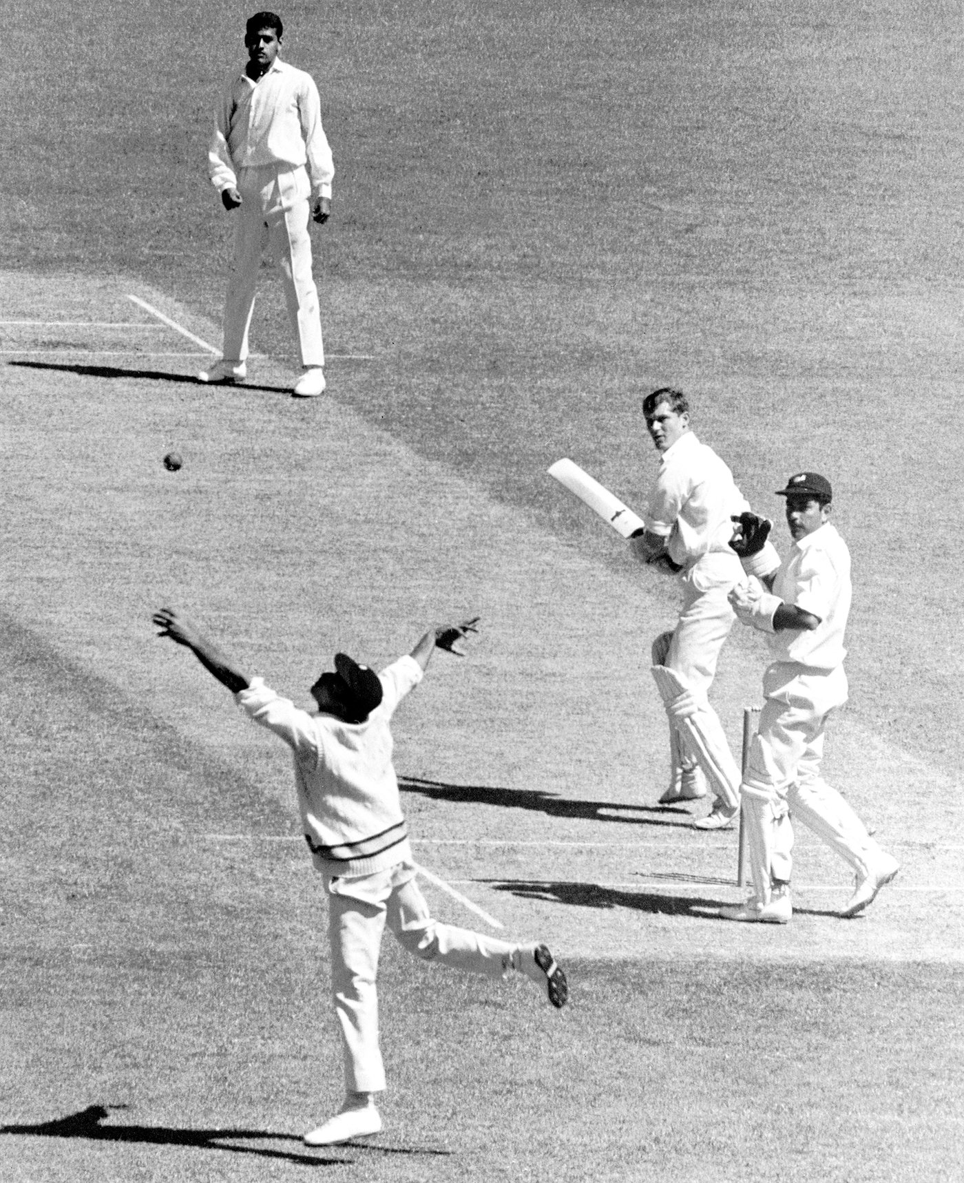 Twenty-two-year-old Chandra bowls to Bob Cowper in a tour game in 1967-68