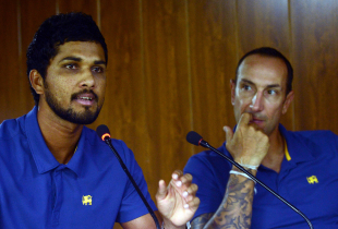 Dinesh Chandimal talks to the press as Nic Pothas looks on
