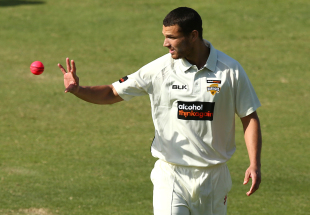 Nathan Coulter-NIle prepares to bowl
