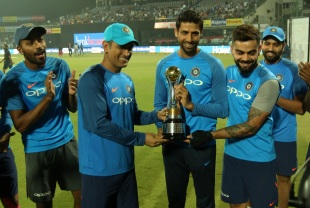 Ashish Nehra is presented with a memento on the occasion of his final international match