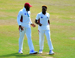 Chesney Hughes chats with Jeremiah Louis, who claimed nine wickets in the game and scored an unbeaten 62