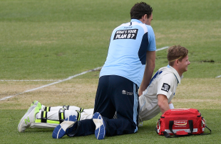 The NSW physio attends to Steven Smith