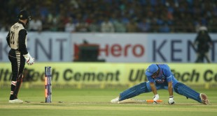 MS Dhoni stretches back into his crease