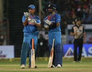 MS Dhoni and Virat Kohli in silent contemplation of the increasing asking rate