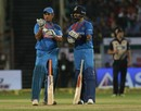 MS Dhoni and Virat Kohli in silent contemplation of the increasing asking rate, India v New Zealand, 2nd T20I, Rajkot, November 4, 2017