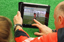 Analyst Paul Jarvis and Natalie Sciver look at a tablet with a video of Sciver's bowling on it, National Cricket Performance Centre, Loughborough, February 18, 2012
