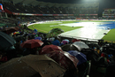 Spectators and the Greenfield Stadium pitch take cover from the rain, India v New Zealand, 3rd T20I, Thiruvananthapuram, November 7, 2017