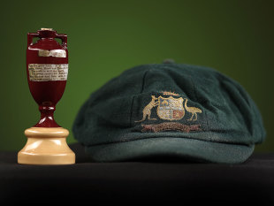 Ashes urn and Baggy Green