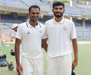 Lukman Meriwala (left) and Atit Sheth wrapped up all ten of Mumbai's wickets between them