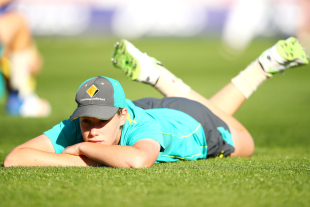 Lauren Cheatle stretches during a training session