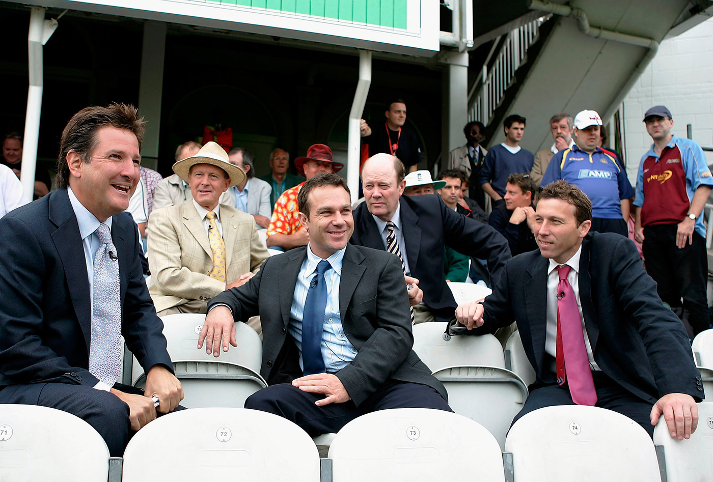 Michael Atherton (far right, first row), with other luminaries of the Channel 4 team, is