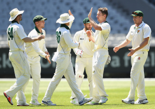 Thomas Rogers celebrates a wicket with his team-mates