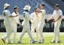 Thomas Rogers celebrates a wicket with his team-mates, Victoria v Tasmania, Sheffield Shield 2017-18, Melbourne, 2nd day, November 14, 2017