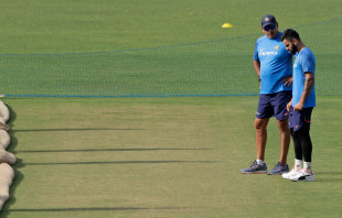 Virat Kohli and Ravi Shastri inspect the pitch