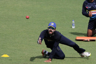 Dinesh Chandimal participates in a fielding drill