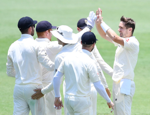 Chris Woakes broke through CA XI's top order with quick wickets