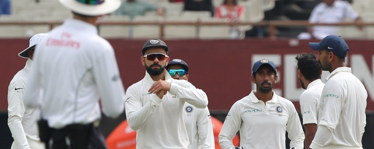Virat Kohli opts for a review