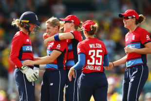 Katherine Brunt is mobbed by her team-mates