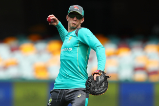 Tim Paine throws a ball during training