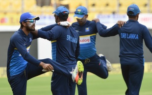 Dinesh Chandimal and his team-mates go through some streches