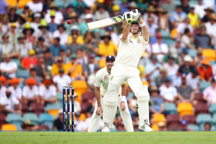 Steven Smith leaps to negotiate with a short ball