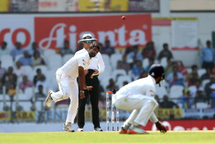 Dilruwan Perera bowls from around the wicket
