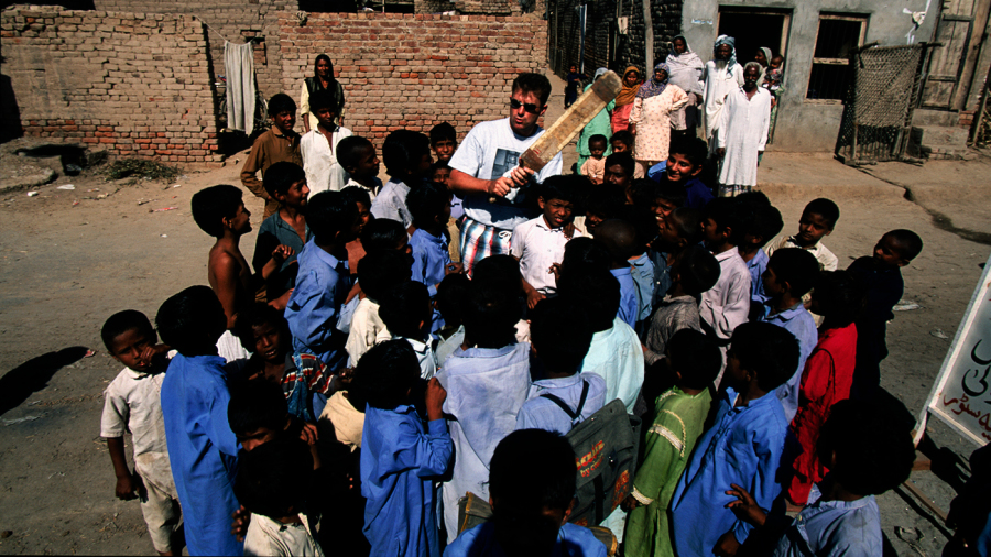 Mark Taylor talks to local kids in Pakistan
