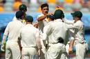 Mitchell Starc is congratulated after one of his three wickets, Australia v England, 1st Test, Brisbane, 4th day, November 26, 2017