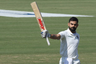 Virat Kohli raises his bat after getting his century