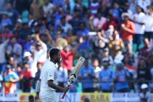 Cheteshwar Pujara walks off to a standing ovation