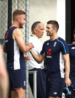Mark Wood catches up with Stuart Broad during an England net session in Brisbane