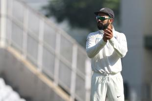 Virat Kohli cheers his team on