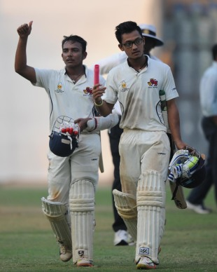 Prithvi Shaw and Jay Bista walk back after sealing Mumbai's win